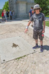 Bridger Lowery at a Masonic monument at Valley Forge